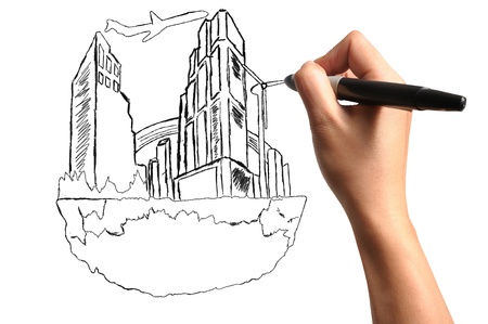 Male Hand drawing floating city photo