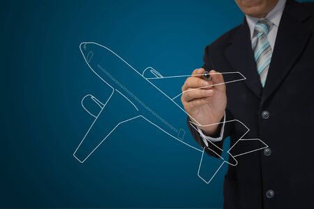 Business Male Hand drawing airplane  photo