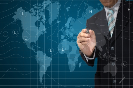 warm weather: business Man drawing weather map. Elements of this image furnished by NASA