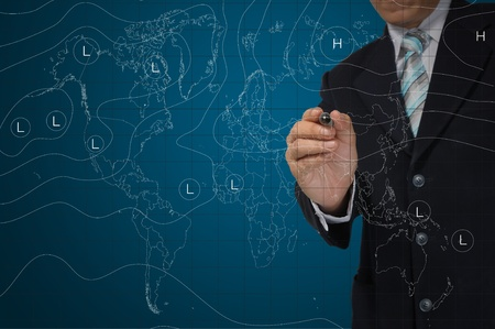weather map: business Man drawing weather map. Elements of this image furnished by NASA