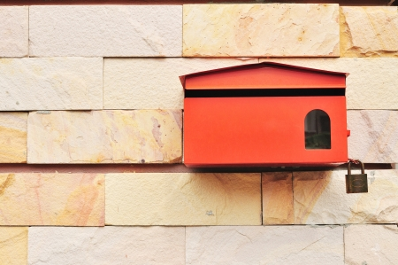 Red Postbox on wall of Sandstone Stock Photo - 15834102