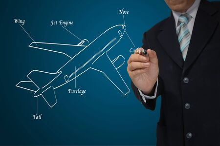 jetplane: Business Male Hand drawing airplane with detail Stock Photo