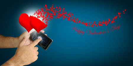 new media: Hand of Business man hold smartphone with Happy Valentine theme Stock Photo