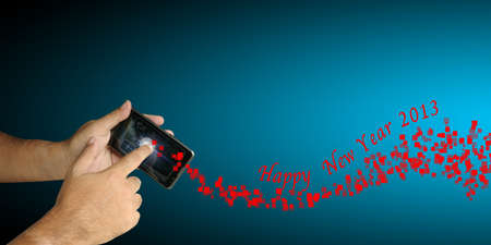 Hand of Business man hold smartphone with Happy New Year 2013 theme photo
