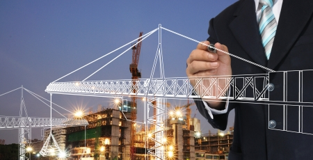 engineering drawing: Business man drawing tower crane