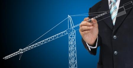 Business man drawing tower crane photo