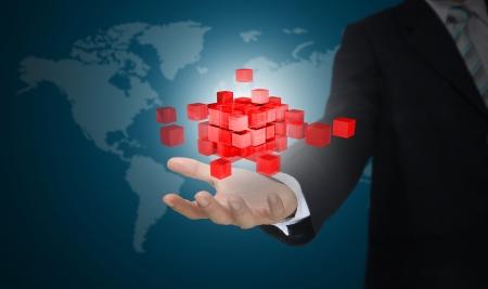 Hand of business Man holding 3d cube made of glass block  Standard-Bild