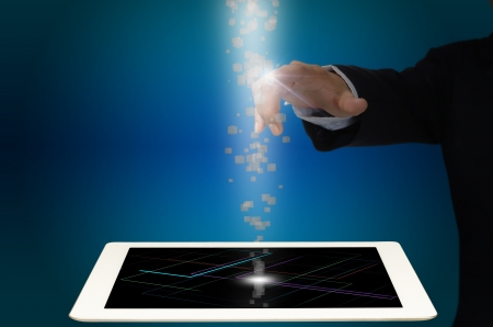 Hand of Business man touch Data cube floating from Tablet PC Stock Photo - 16186459