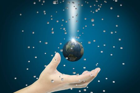 Hand of Business man earth globe with 3d cube photo