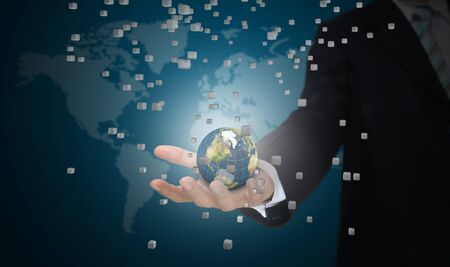 world security: Hand of Business man earth globe with 3d cube Stock Photo