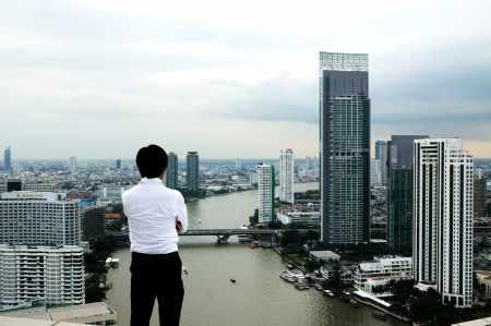 Business Man Looking at the city from above