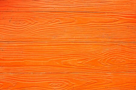 Texture background of orange artificial wood board  photo