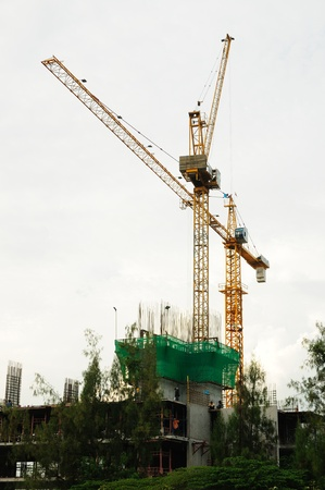 Tower crane beside construction site