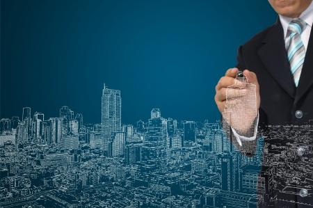 Architect or Business Man draw cityscape Фото со стока