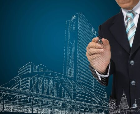 Architect or Business Man drawing cityscape photo