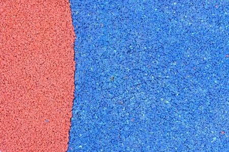 Texture of color rubber floor on playground. ( Ethylene Propylene Diene Monomeror EPDM) photo
