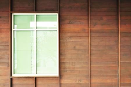 Glass window on wood wall photo