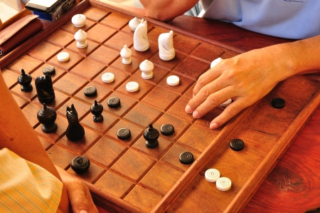 Thai People or Men Playing Thai chess photo