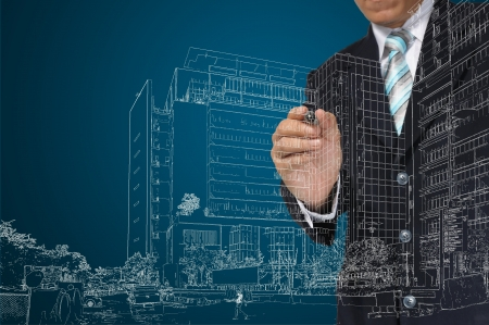 Business Man or architect draw building and cityscape photo