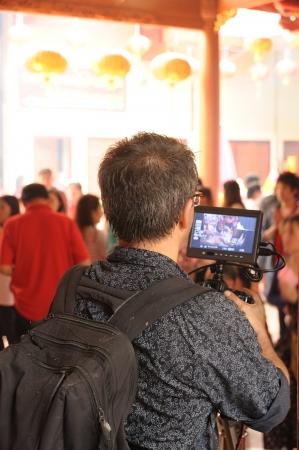 taking video: Camera man taking video