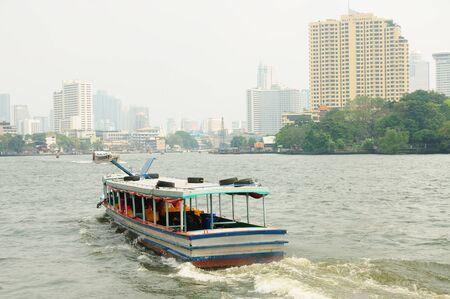 praya: Boat in the river of Chao Praya in Bangkok, Thailand  Editorial