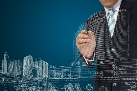 project manager: Business Man or architect draw building and cityscape