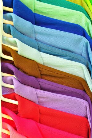 clothes hangers: Row of Multi color T-shirt