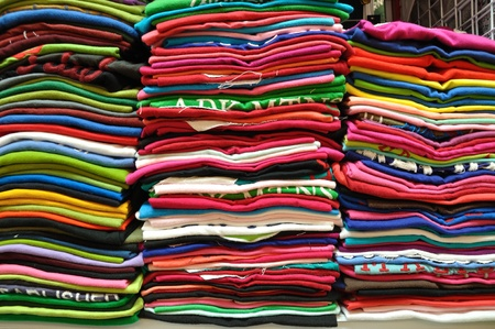 Stack of Colorful t-shirt for use as Background photo