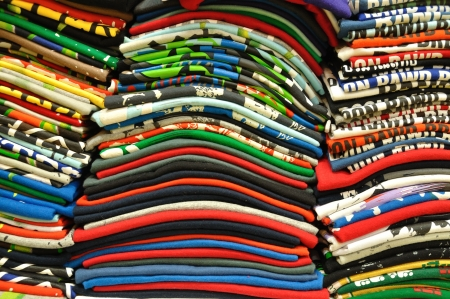 multi colors: Stack of Colorful t-shirt for use as Background