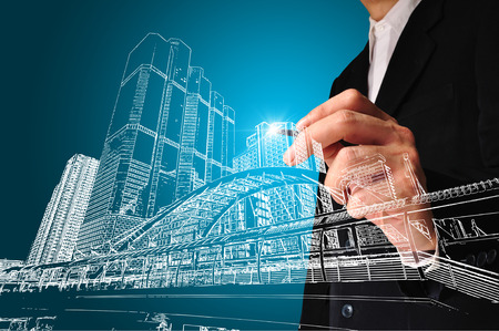 cad drawing: Business man or achitect draw the drawing of building or cityscape