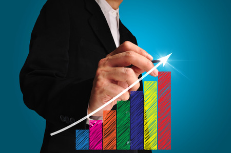 business man write over achievement bar chart or graph photo