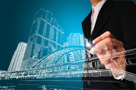 Business man or achitect draw the drawing of building or cityscape photo