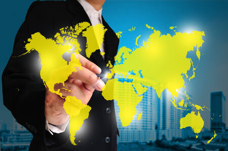 multinational: Global business concept with businessman that draws a world map   Element of this image furnished by NASA