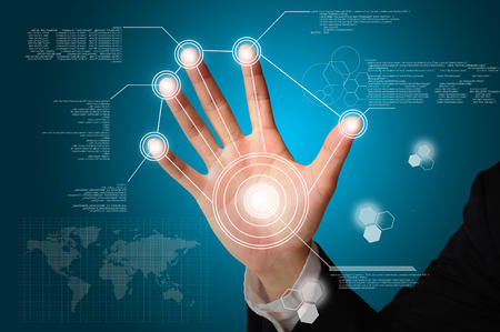 successful future: Hand of Business man touch on digital virtual screen Stock Photo
