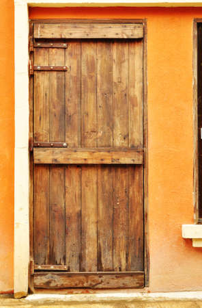 European styl wood door on concrete wall photo