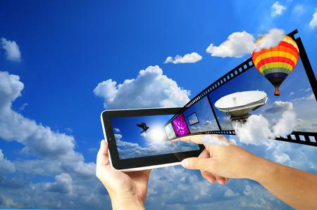 Female Hand hold digital tablet present Full HD 3D movie Stock Photo