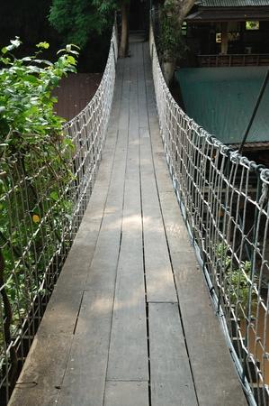 Suspension bridge across the water photo