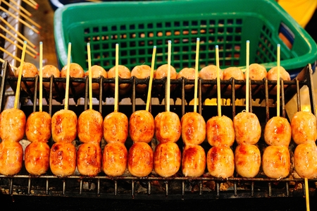 Thai Style Grilled Sausage on Street Market in Thailand photo