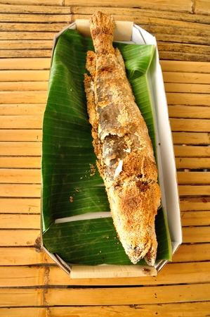 snakehead: Grilled Snakehead cover with salt on Banana Leaf