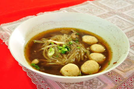 thai noodle soup: Thai Noodle Soup with Meatball.  It is called Kuay Tiew Ruay