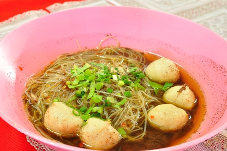 thai noodle soup:  Thai Noodle Soup with Meatball.  It is called Kuay Tiew Ruay  Stock Photo