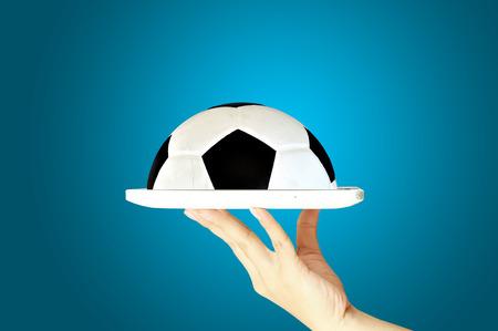 Female Hand hold digital tablet present Soccer Ball photo