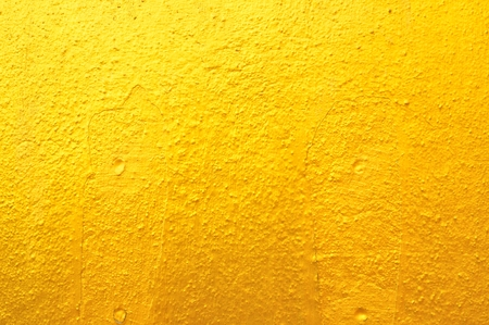 Texture Background of Old Gold Concrete Wall photo