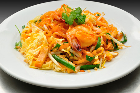 Pad Thai with Fresh Shrimp Covered with Fried Egg. photo