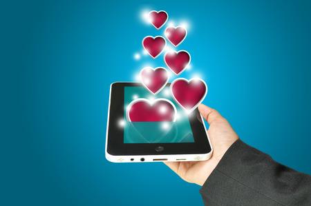 lindt: Female Hand hold digital tablet present Heart. Valentines day concept