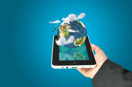 hand holding globe: female hand holding a tablet touch computer gadget present earth globe and airplane as transportation concept.  Stock Photo