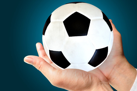 businessman or Manager holding a soccer ball, close up  photo