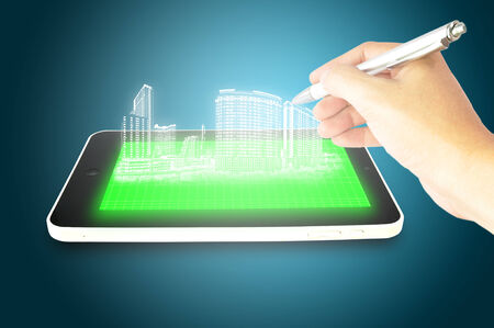 hologram: Male hand draw 3D hologram building on Tablet Touch screen