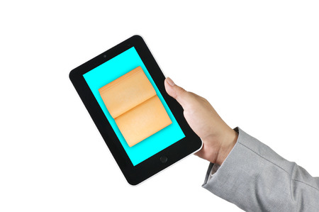 Male Hand Holding touch screen tablet and Book as e-book and e-document concept photo