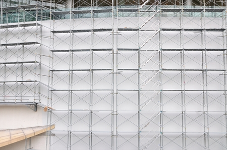 overbuilding: Scaffolding on a construction site for use as Illustration